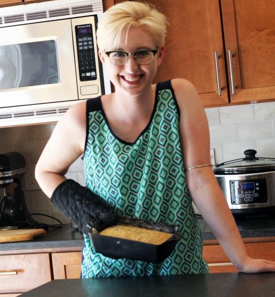 blonde chef in kitchen with bread